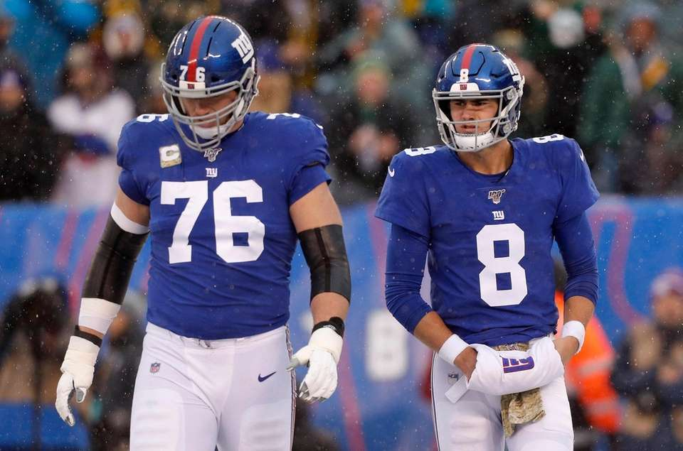 Daniel Jones #8 and Nate Solder #76 of