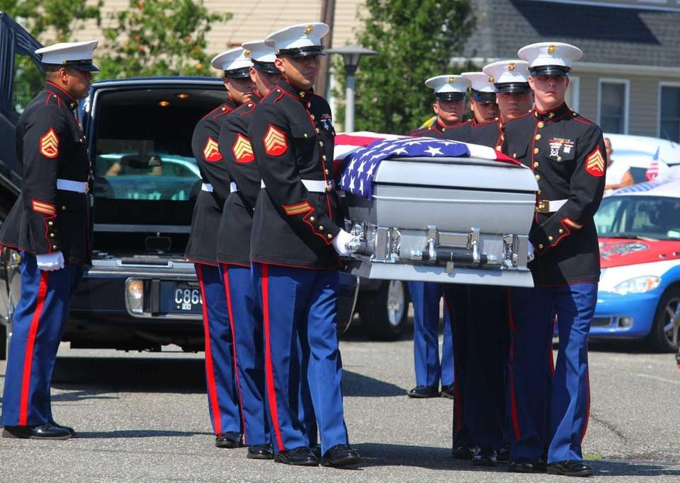 The coffin carrying the body of fallen Marine