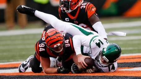 Jets quarterback Sam Darnold is sacked by Bengals