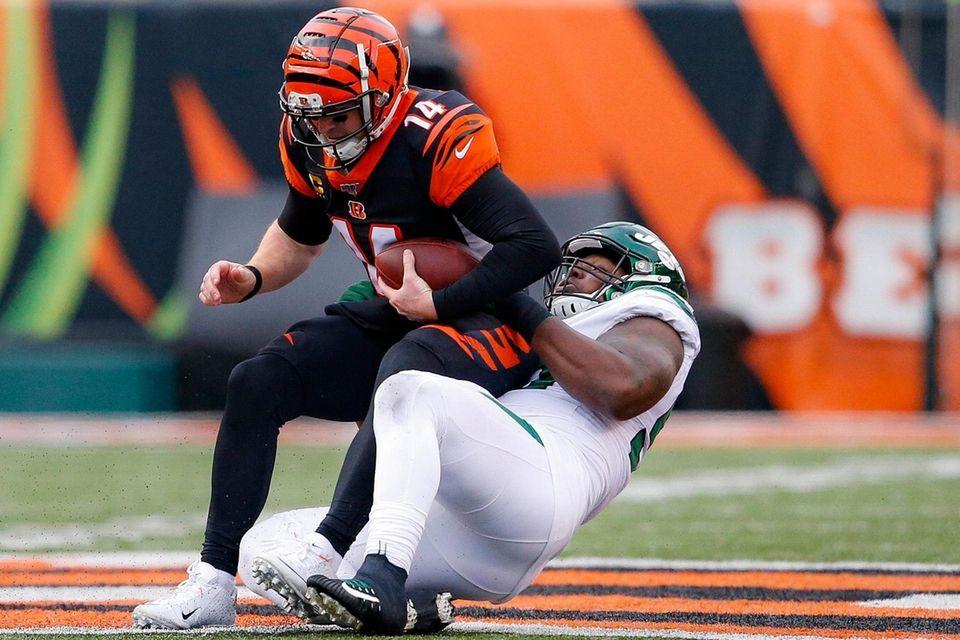 Cincinnati Bengals quarterback Andy Dalton is sacked by