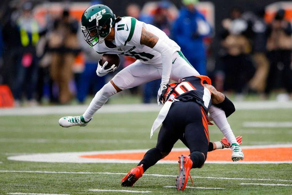 Jets wide receiver Robby Anderson is tackled by