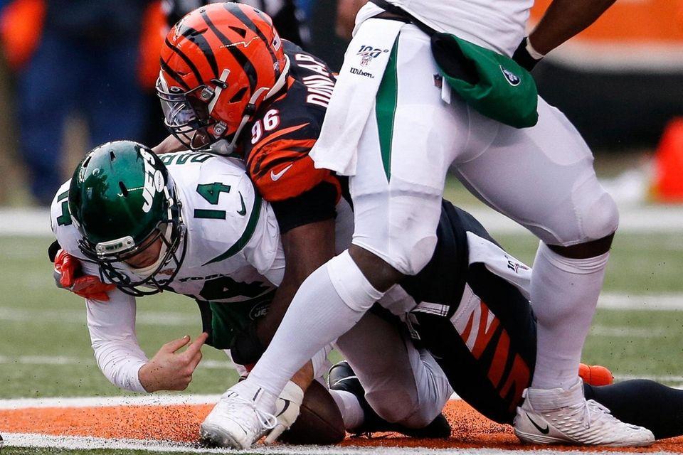 Jets quarterback Sam Darnold is sacked by Cincinnati