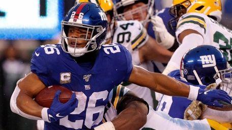 Saquon Barkley of the Giants is taken down