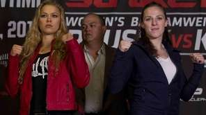 Strikeforce women's bantamweight champion Ronda Rousey, left, and