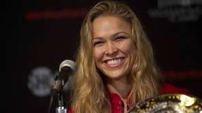 Strikeforce women's bantamweight champion Ronda Rousey speaks at