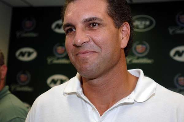 Vinny Testaverde talks to the media after holding