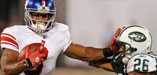 Victor Cruz stiff-arms Dwight Lowery during the fourth