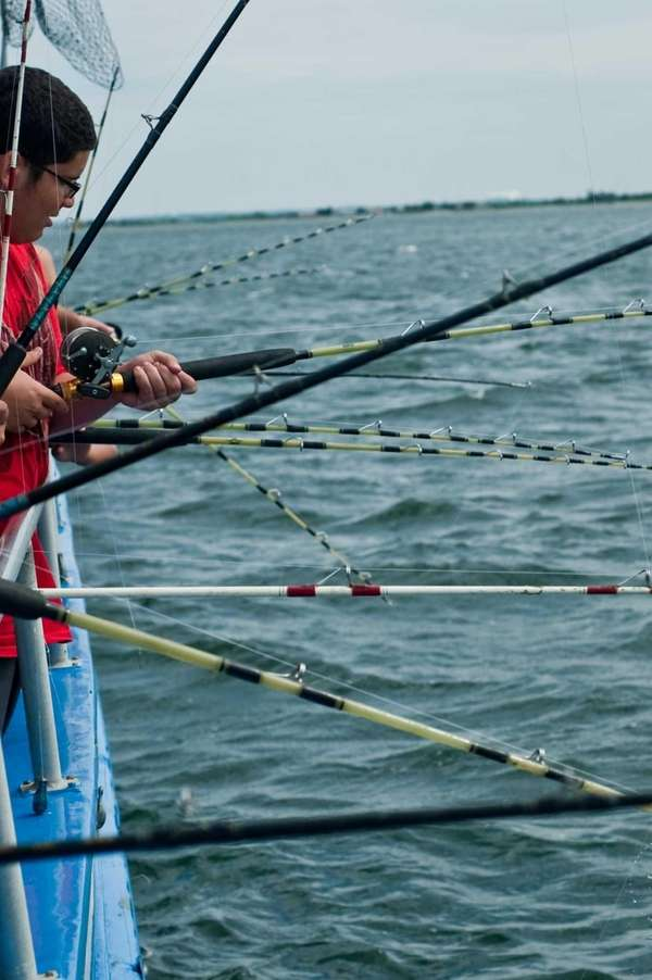 With many fishing poles set down into the