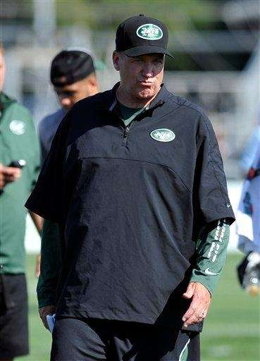 Rex Ryan looks on during training camp in