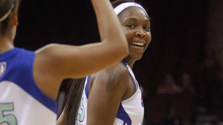 Cappie Pondexter is congratulated by teammate Leilani Mitchell