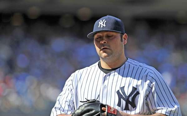 Joba Chamberlain has his eyes closed as he