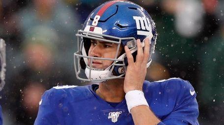 Daniel Jones of the Giants looks on during
