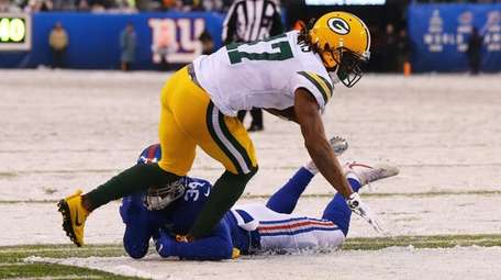 Davante Adams of the Packers is tackled by