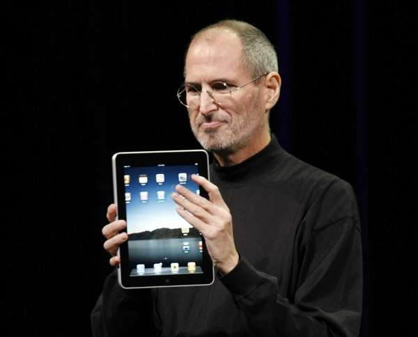 Apple CEO Steve Jobs shows off the new
