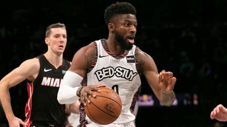 Nets guard David Nwaba is guarded by Heat