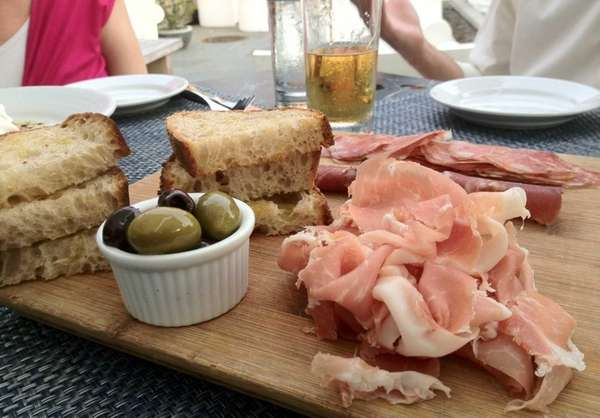 An appetizer of assorted of cured Italian meats