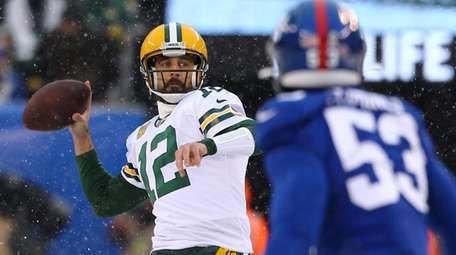 Aaron Rodgers of the Packers looks to pass