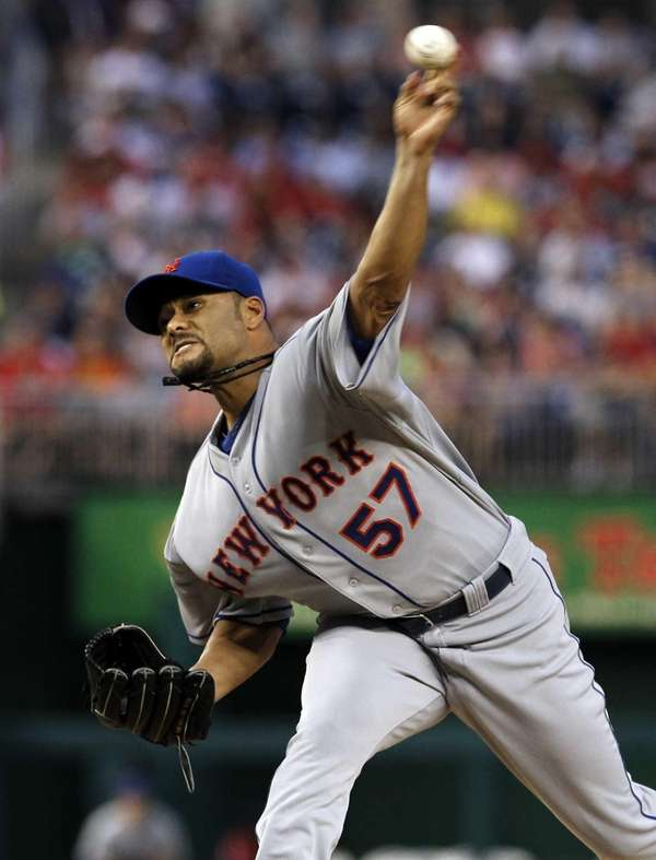 Mets starting pitcher Johan Santana delivers to the