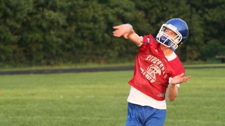 Riverhead quarterback Ryan Bitzer will let it fly
