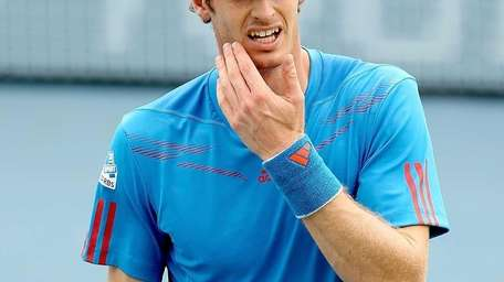 Andy Murray wipes his eyes between points while