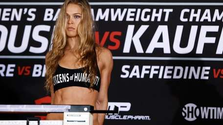 Strikeforce women's bantamweight champion Ronda Rouse at weigh-ins