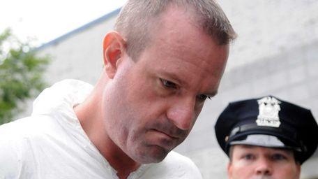 David Boutin, 42, of West Hempstead, is led