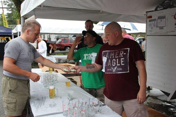 Chris Ferguson, 30, of Riverhead, gets a beer