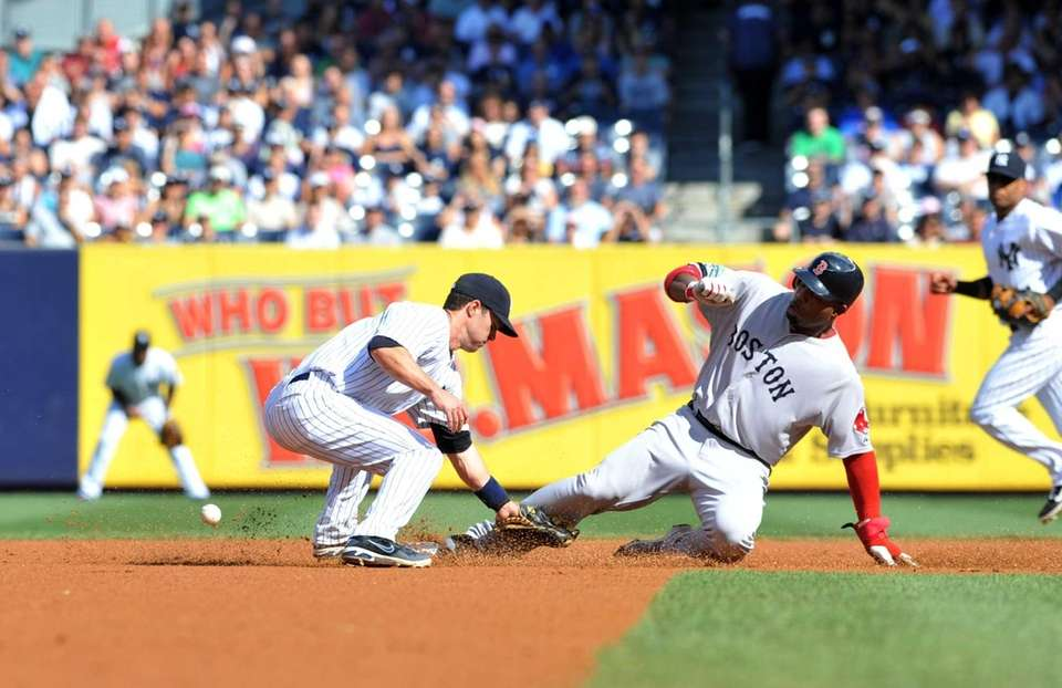 Red Sox outfielder Carl Crawford steals second base