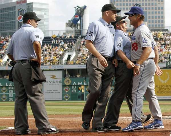 Umpires Tim Tschida and Jeff Nelson get in