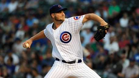Chris Volstad of the Chicago Cubs pitches against