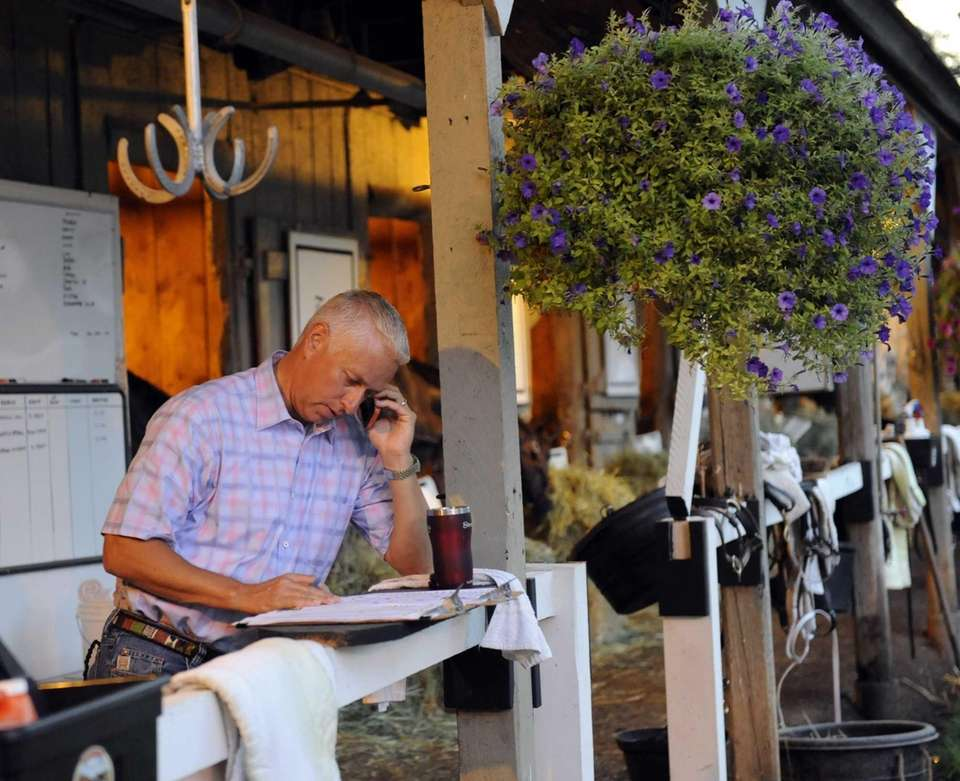 Todd Pletcher works in the early morning light