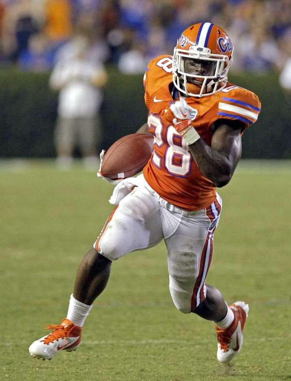 Florida running back Jeff Demps carries against Florida