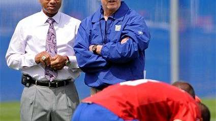 Tom Coughlin and general manager Jerry Reese, left,
