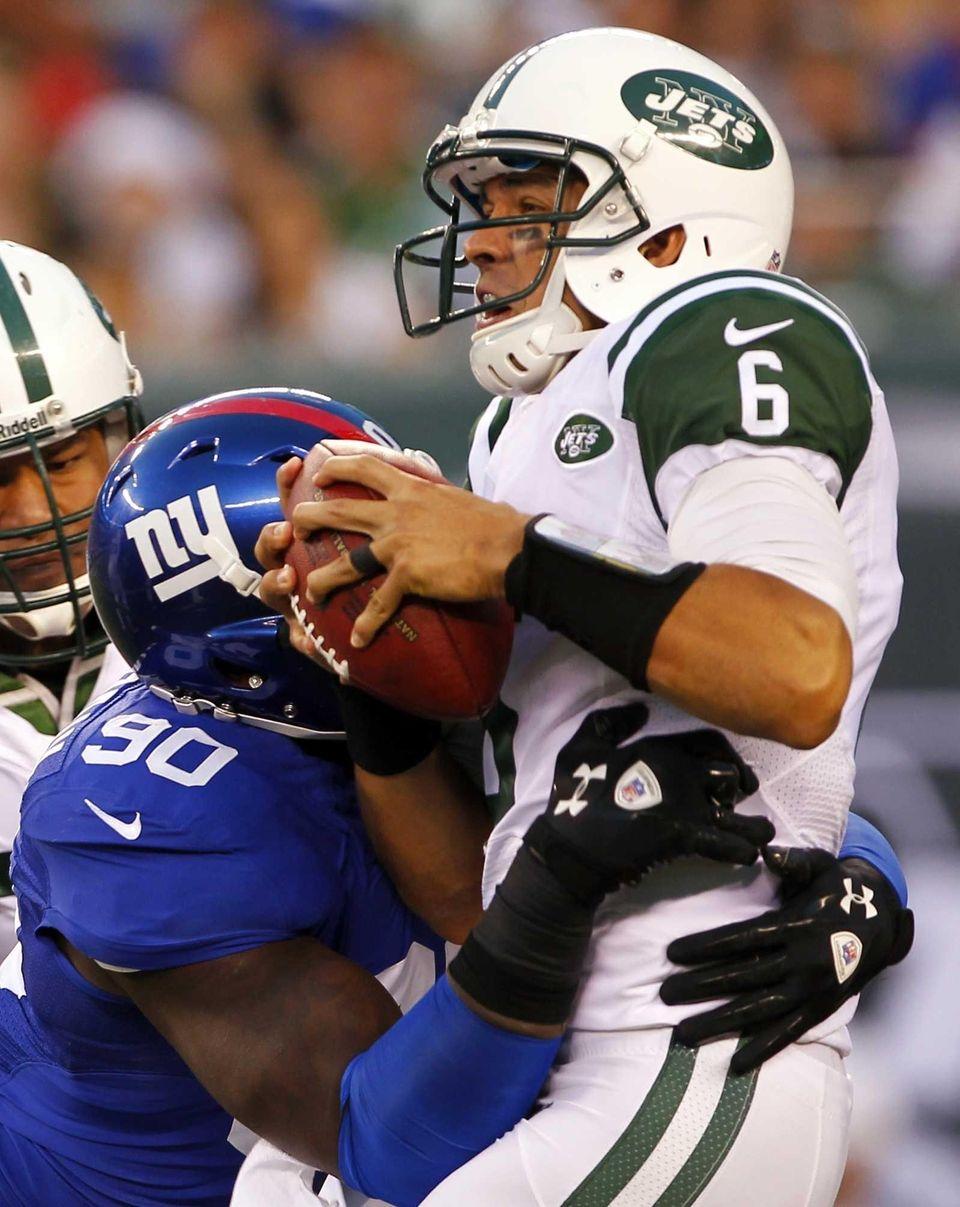 Jason Pierre-Paul sacks Mark Sanchez. (August 18, 2012)