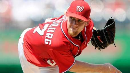 Stephen Strasburg of the Washington Nationals pitches against
