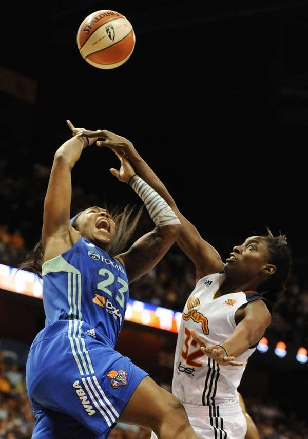 Connecticut Sun's Kalana Greene, right, fouls Cappie Pondexter