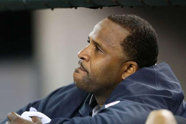 CC Sabathia watches the action from the dugout