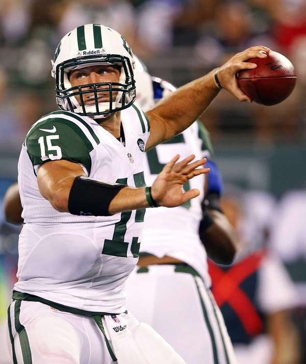 Jets quarterback Tim Tebow throws a pass against