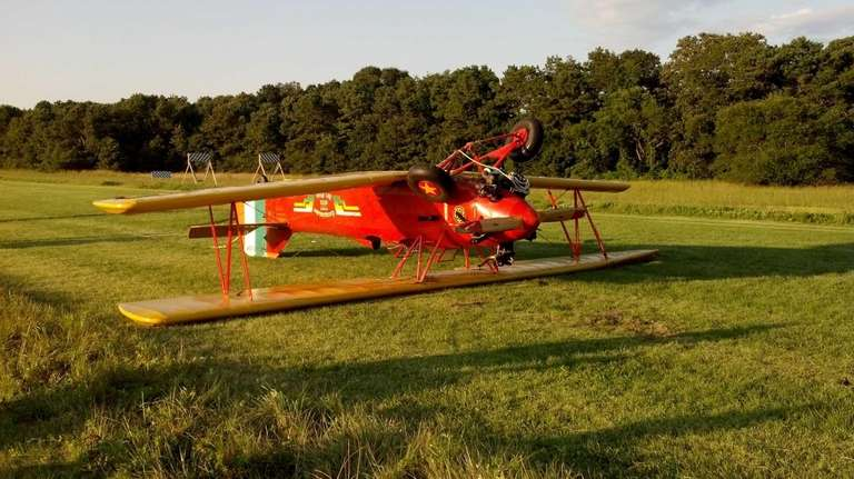 A single-engine plane flipped over during landing Saturday