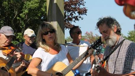 Terri Hall, of Bellport, sing and play along
