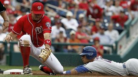 Washington Nationals third baseman Ryan Zimmerman can't make