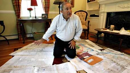 Tony Segreto among the maps and surveys he