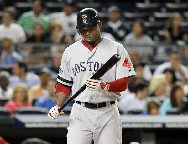 Carl Crawford looks at his bat in the