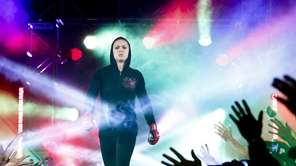 Bantamweight champion Ronda Rousey makes her way to
