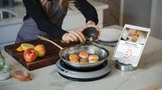 The Hestan Cue Smart Cooking System includes an