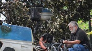 NTSB investigators probe a single-engine plane where it