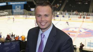 Play-by-play broadcaster Brendan Burke prepares to work a