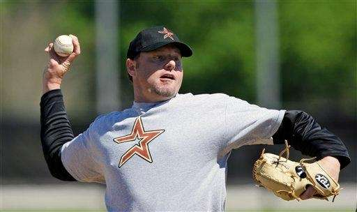 Roger Clemens pitches during a workout with minor