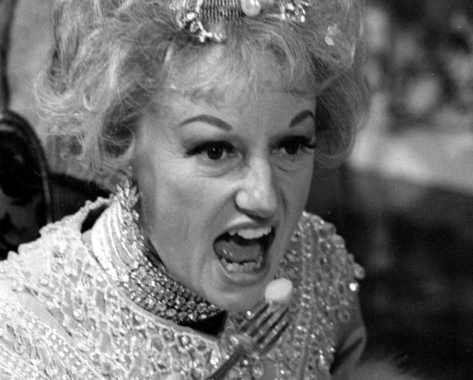 Comedian Phyllis Diller appears in character in the