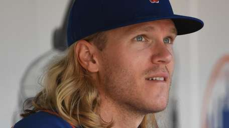 Mets starting pitcher Noah Syndergaard looks on from